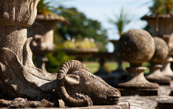 Stone sculpure of a ram at the base of a pot, in the royal gardens of Osborne House