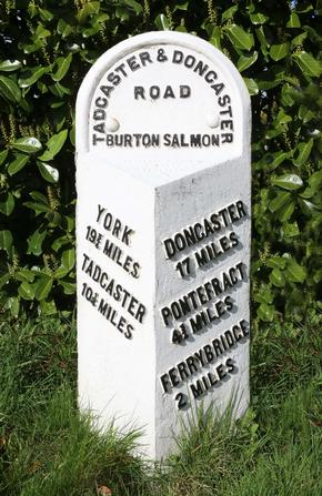 Old British road milestone showing distances to York and Tadcaster, Ferrybridge, Pontefract and Doncaster.