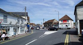 A view of the High Street at Dymchurch, Kent, UK, looking from Eastbridge Road (c) Ian Dunster via Wikimedia Commons