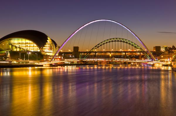 The lights of the Tyne Bridges at Gateshead, photographed at sunset