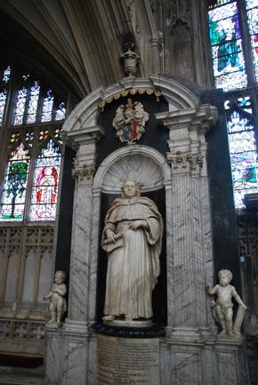 Large statue that is a memorial to Johannes Powell in Gloucester Cathedral