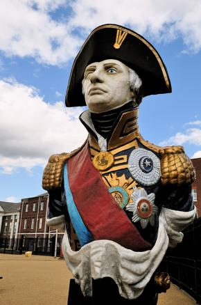Figurehead of Vice Admiral Horatio Lord Nelson from HMS Trafalgar on display at Portsmouth Historic Dockyard, Hampshire, UK.