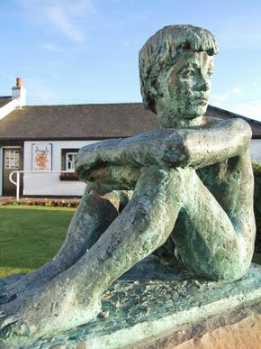 The monument of the dreaming boy - statue in Gretna Green, Great Britain.