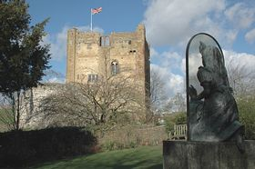 Guildford Castle Keep from the Alice Through The Looking Glass statue in castle grounds © Sue Waugh