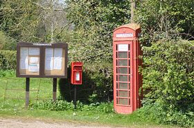 Village notice board, letter box and phone box © Russ Hardingham