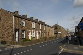 Burnley Road - the corner house is number 99 and once the home of Levi and Laura Hargreaves © Mervyn Jones