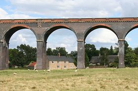 The railway viaduct towers over the village of Harringworth. © Roger Gurney