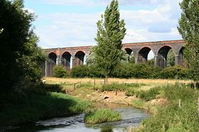 The River Welland is an infant as it flows through Harringworth beneath the viaduct. © Roger Gurney