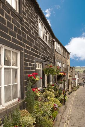Traditional Mill Cottages in Haworth with Hanging Baskets and Flowers