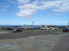 Seaward view over shops at John O' Groats © James E Craig