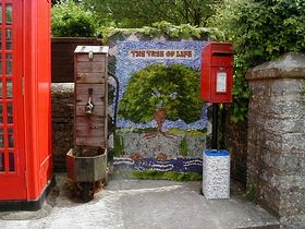 The village pump with the annual well dressing beside it © Willow Bank