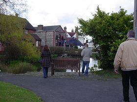 View of the pond in the village centre looking down High Street. © Vicky (vita) Searle