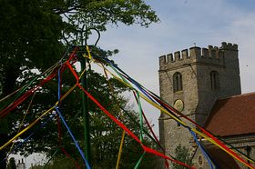 Maypole Dancing on May Day, in the school playground next to the church, © Kate Pendlenton