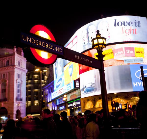 Piccadilly Circus showing London Underground sign in foreground and colourful neon signs in background