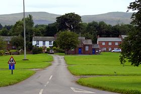 Milburn Green with the small school in the background © Johnny Acton