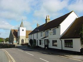 Looking down the High Street. Pointer Inn pub, Clematis self-catering lodging and All Saints Church built in 11 century. © Mark Lansbury