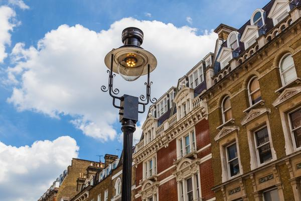 Old street lamp with old buildings in background, in Notting Hill