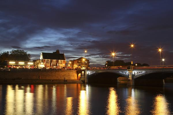 View of Trent Bridge at night with lights reflecting in the river