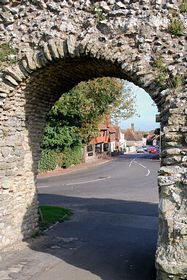 Pevensey seen through an arch in the castle outer wall © S Lewry