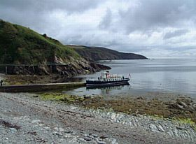 A pleasure boat arrives at Port Soderick © Bob Jones