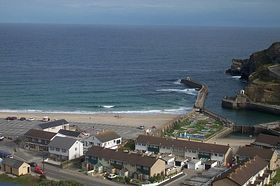 Portreath beach, harbour and town © Dave Quinnell