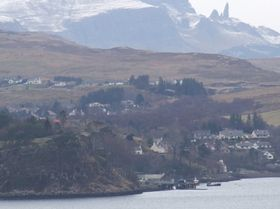 Portree and the Old Man of Storr in background on a dull day © Charlie Millar