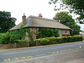 Pretty Thatched House. © Peggy Cannell
