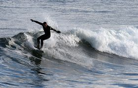 Surfing at Sandend © T. Asher