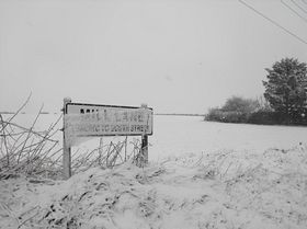 Mill Lane sign in the snow © Madelaine Phillips