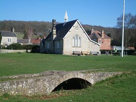 Old packhorse bridge and former school © Philip Cookson