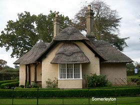 One of the numerous pretty thatched cottages © Peggy Cannell