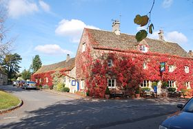 The Swan, a 17th century Cotswold Inn on the village green of Southrop © Ellen-Diane Taylor