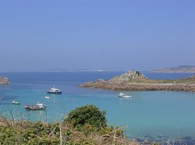 St Agnes and Gugh - Tresco and St Mary's in the distance - photo by Chris Bradley