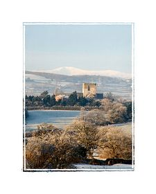 St Asaph Cathedral with A snowcapped Mount Snowdon in the background. © Rosemary Williams