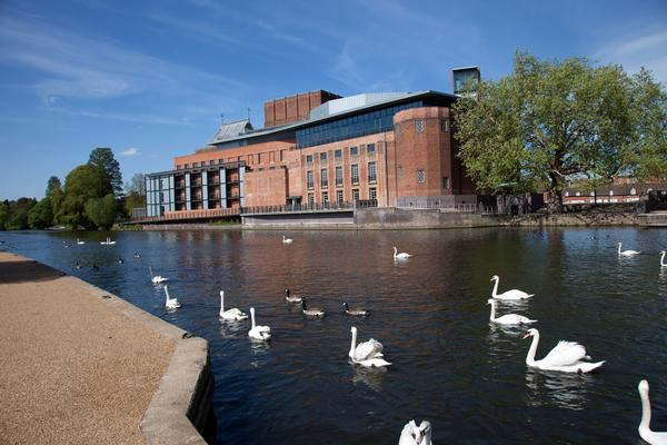 RSC Theatre with swans on the River Avon in foreground