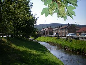 The stream flowing through the village centre © Philip Cookson
