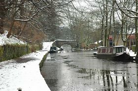 Wintertime with Narrowboats on The Huddersfield Canal in Uppermill